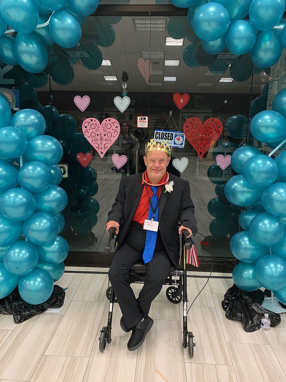 Looking like the king of the castle riding in to celebrate with teal balloons.
